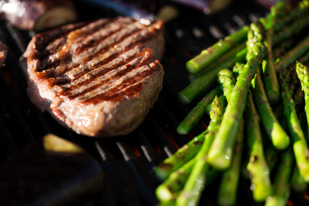 steak: Steak and vegetables on grill at sunset, candid