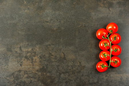 ��copy space �: Tomatoes on dark table with copy space