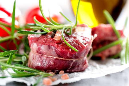 peppercorns: Raw beef steak with peppercorns and herbs