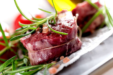 porterhouse: Raw beef steak with peppercorns and herbs