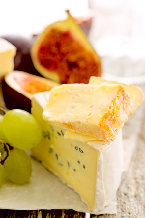 manjar: Delicacy cheese and fruit plate on table, closeup
