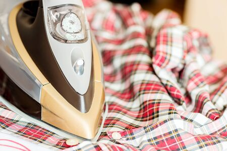 steam iron: Close-up Ironing Clothes On Ironing Board