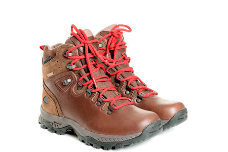 hiking trail: A pair of hiking boots. Isolated on white background Stock Photo
