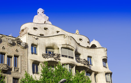modernism: BARCELONA, SPAIN - JULY 13: Modernism style architecture. Casa Mila aka La Pedrera (Catalan for The Quarry) on July 19 2012. This house was built during 1906 - 1910. Editorial