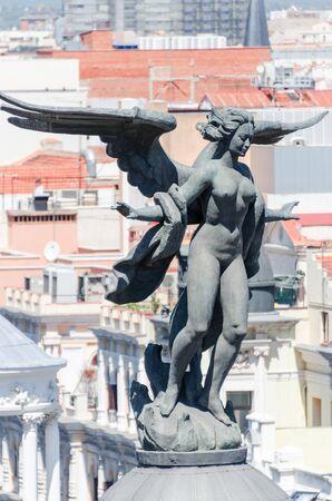 metropolis: Angel sculpture on Metropolis building in Madrid, Spain Stock Photo