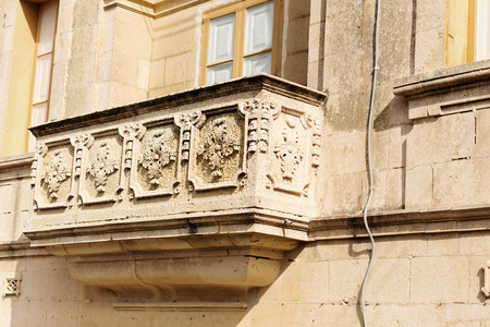 historical building: Balcony details on historical building at Malta