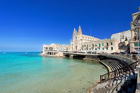 ST JULIANS, MALTA - APRIL 13, 2014: Our Lady of Mount Carmel Church on Balluta Bay in St. Julian's, Malta on April 13, 2014. Editorial