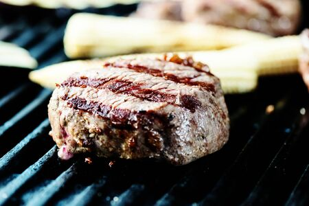 nightime: Real beef steak on grill with vegetables