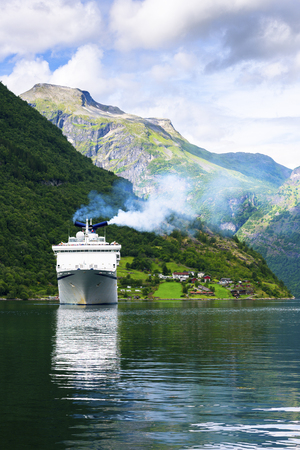 hardanger: Cruise ship in fjord near Geiranger Stock Photo