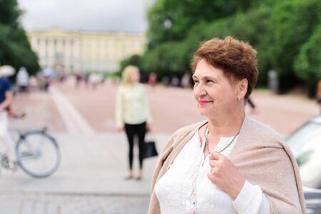 Woman standing on a street Karl Johans Gate,Oslo