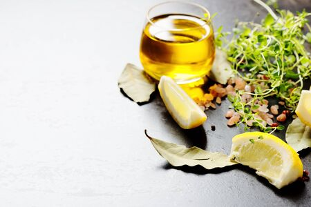 Oil, lemon and spices Stock Photo