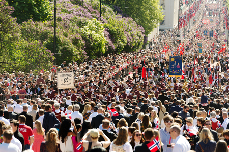 17th: Oslo, Norway, 17th May 2014: National day in Norway. Norwegians at traditional celebration and parade on Karl Johans Gate street.