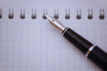 diagonal diary education: pen on note book close up isolated Stock Photo