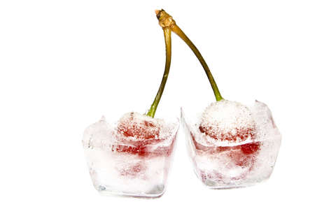 close-up of two frozen cherries on white photo