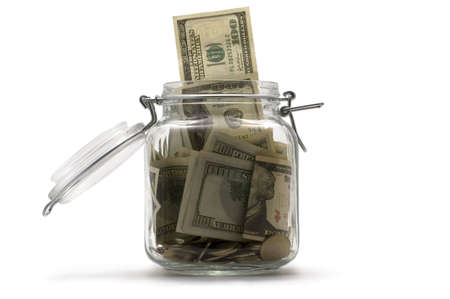 pricey: jar with the money on white Stock Photo