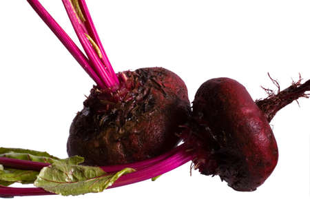 two red beets on white photo