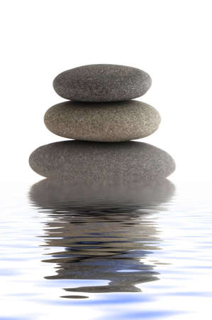 balanced rocks: three balanced rocks in water