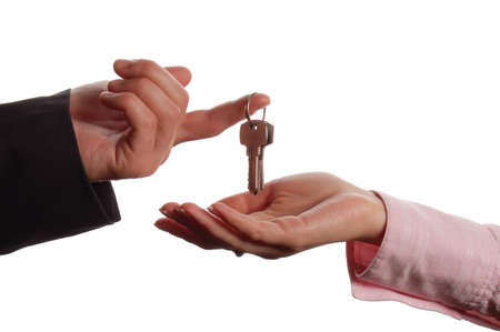 in escrow: Man handing a women a set of keys Stock Photo