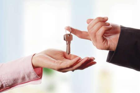 Man handing a women a set of keys photo