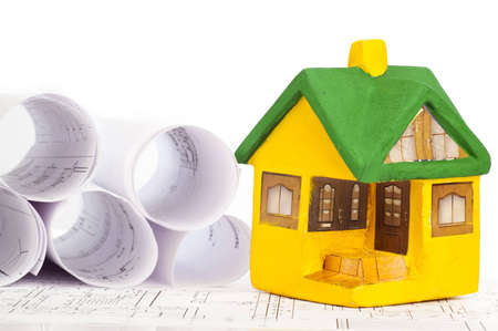small model house on drawing  photo