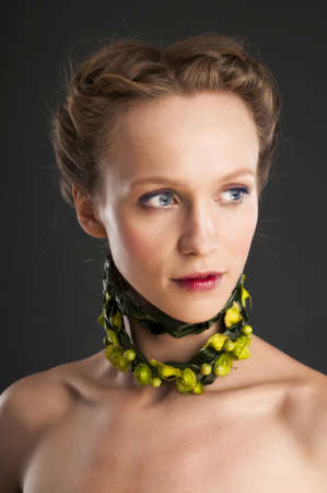 floristic: Attractive girl portrait with floristic necklace.Concept of natural beauty.