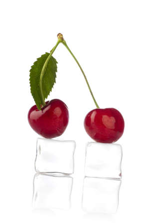sweet cherry with frozen ice cube on white photo