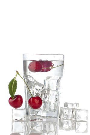splashing water in glass with ice cube and cherry photo