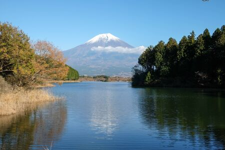 The beauty of Mount Fuji  that reflects water in the autumn season. Stock Photo