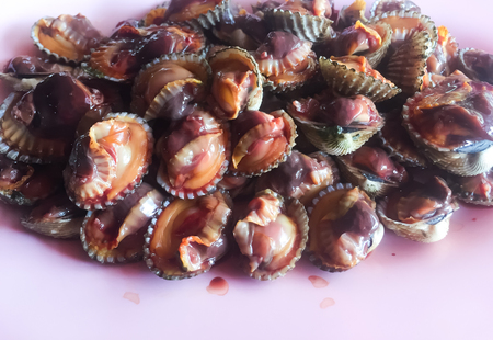 They are the medium parboiled cockles. The restaurant will remove their shell for you. It might come with their blood but it is edible. Normally, Thais eat them with dipping spicy sauce. It is Thais