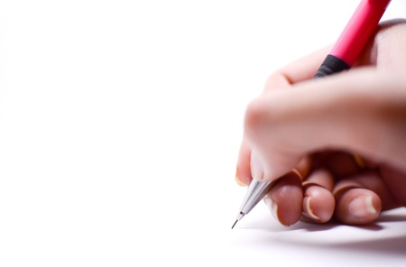 A woman's hand is writing something with a pink pencil, isolated on white background. There are the empty space on the left side which should be used as background or a card.