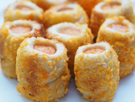 Chicken sausage roll made from bread with cheese sprinkles in small bite size Reklamní fotografie