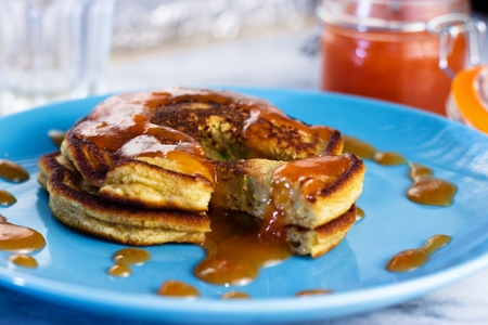 Close up on stack of homemade gluten free pancakes with peach jam