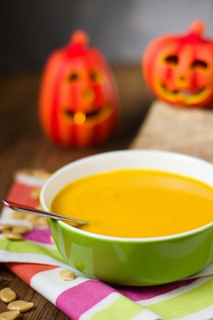 Green bowl of simple plain hot pumpkin soup. Homemade hearthy seasonal food
