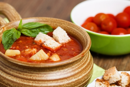 Detail of homemade tomato soup with white bread croutons Stock Photo