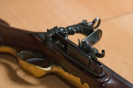 Lock and trigger of antique firearm Stock Photo