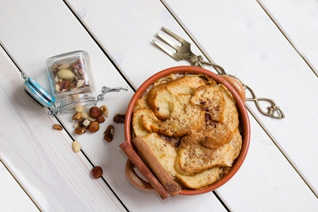 Directly above view on earthenware pot full of bread pudding Stock Photo