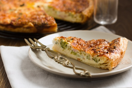 Slice of vegetable pie, or quiche, served on a plate Stockfoto