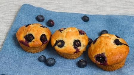 Fresh homemade gluten free blueberry muffins on denim napkin