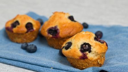 Homemade gluten free blueberry muffins on denim napkin