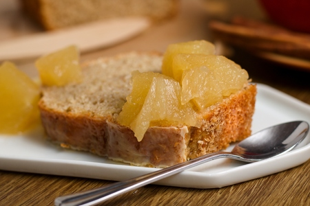 Slice of batter cake with stewed apples