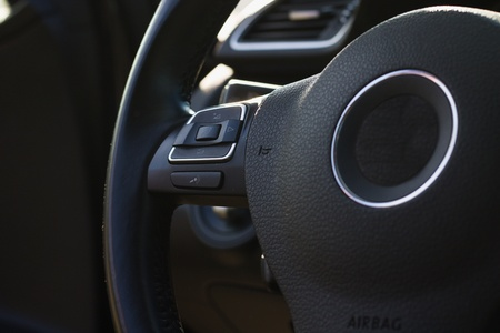 Steering wheel with remote radio controls in european car Stockfoto