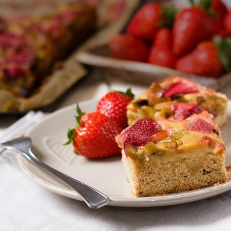 Serving of fresh summer dessert - strawberry pie with rhubarb
