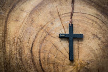 A mini cross on the wood table. Stock Photo