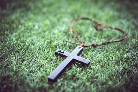 A mini cross on the grass. 写真素材