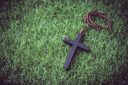A mini cross on the grass. Stock Photo