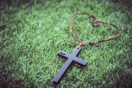 A mini cross on the grass. Banco de Imagens
