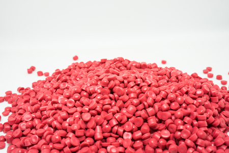 Red Plastic pellets. Colorant for plastics. Stock Photo - 91343145