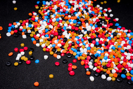 Mix Plastic pellets. Colorant for plastics. Banco de Imagens