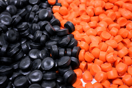 Black&Orange Plastic pellets. Colorant for plastics.