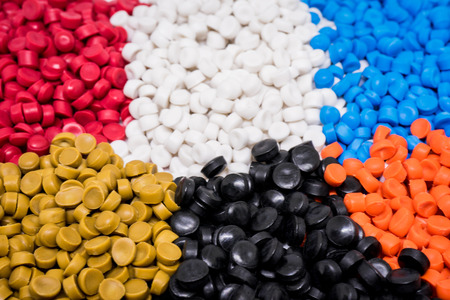 Mix Plastic pellets. Colorant for plastics. Stock Photo